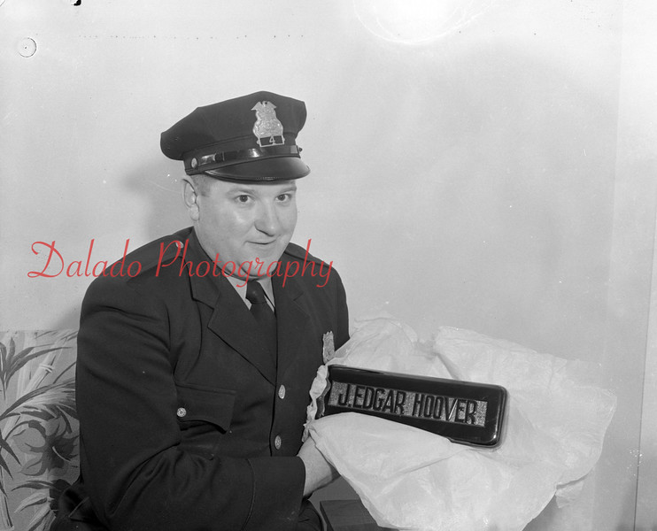 (11.05.53) Officer and a plaque.