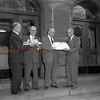 (Oct. 1955) Presenting petitions signed by 11,884 county voters drafting John U. Shroyer and Dr. George Deitrick as candidates for commissioners in the general election are Joseph Donahue, left, and the Rev. John Fryberger, right. Accepting the petitions are Commissioners Shroyer and Deitrick.