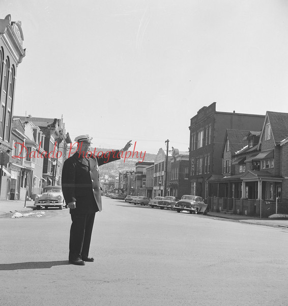 Policeman directing traffic on Oak Street.