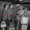 (April 1954) Law enforcement looks at confiscated slot machines.