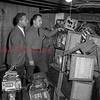 (April 1954) Law enforcement looks at confiscated slot machines.