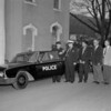 (March 1960) City Patrolman Marlin Witmer receives the keys to a new vehicle from Chief George Haddock. Also present are Joseph Dusick, third from left, Fred Granzow and Joseph Hoberg.