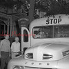 (08.23.1951) A trooper from the state police checking out a school bus.