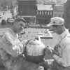 (April 1959) Frank Barvitski, left, and Ed Fleming put finishing touches to a huge ball, which sets atop the Shamokin Post Office.