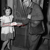 (12.01.53) The first customer of mailman George Straub's route to contribute to the muscular dystrophy drive was little Mary Alice Wagner, of 819 N. Rock St.