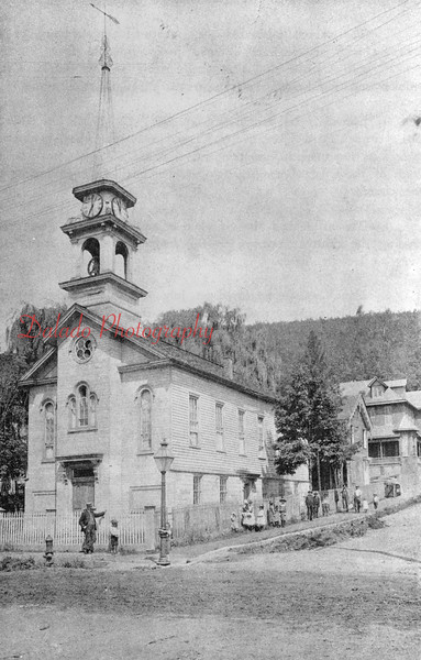 """(1864) First Presbyterian Church- The church was organized on April 18, 1845, by the founder of Shamokin, John C. Boyd. It was first called """"Shamokintown Church."""" The name was changed 27 years later to its present name. The church seen here was erected in 1847 by Stephen Bittenbender on a tract of land donated by the honorable Lewis Dewart. The first pastor was Rev. James J. Hamilton. A pastor's house was built in 1894 at a cost of $3,403.43, most of which was raised by the women of the church. In 1890, a new church and chapel were built for $40,000. In 1927, a Sabbath school and entertainment structure was completed at a cost of $82,000."""
