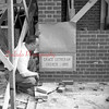(1956) Rev. Robert Arentz, past of Grace Lutheran Church, looks at the new corner stone. The original church was destroyed by fire in Feb. 1955.