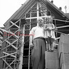 (1956) Rev. Robert Arentz, past of Grace Lutheran Church, and his daughter, Kristin, stand in front of the new entrance of the church. The original church was destroyed by fire in Feb. 1955.