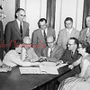 This picture is of the Grace Lutheran Church council looking at plans for rebuilding after a fire destroyed the church on Feb. 20, 1955.  The older gentleman sitting at the table with the silk tie is Dr. C. C. Billig. Dr. Billig was head of the church council and an optometrist in Shamokin for many years.