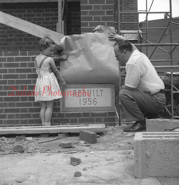 (1956) Rev. Robert Arentz, past of Grace Lutheran Church, and his daughter, Kristin, look at the new corner stone. The original church was destroyed by fire in Feb. 1955.