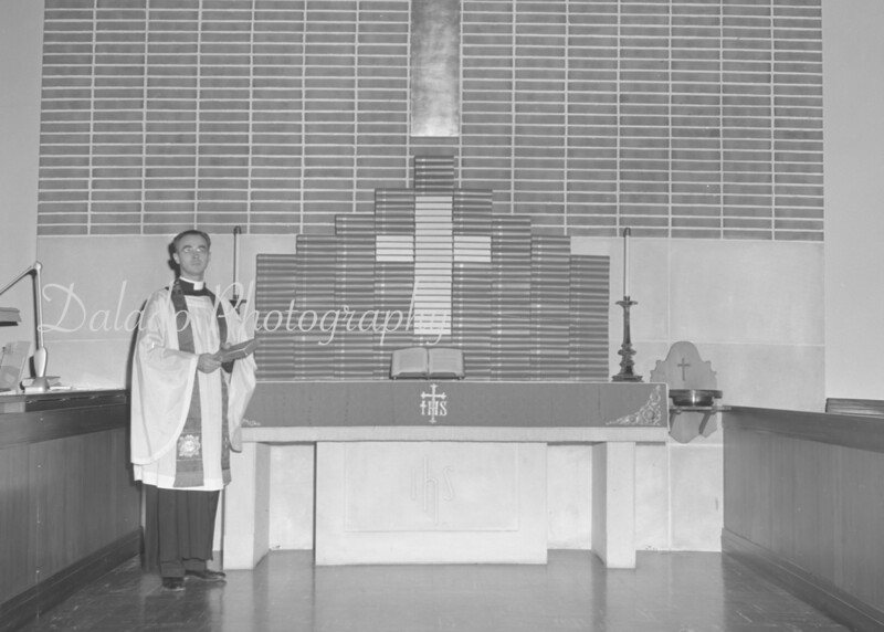 (March 1961)  Rev. Charles Souders with 225 new hymnal and service books at Grace Lutheran Church, Shamokin.