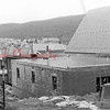 (Winter 1981) A worker from Brookside Construction Co. works on the roof of a new addition to Grace Lutheran Church.