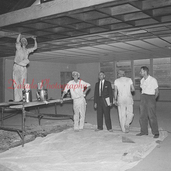 (August 1960) The pastors of Himmels Church near Rebuck stand before the cornerstone. The Rev. Jacob Singer, Herndon, left, and Rev. Paul Billow, Urban, are shown. A fire in January 1959 destroyed the old church, which was built in 1818. The building committee, led by Mark Kieffer, view the progress.