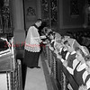 (11.19.1952) Ring day at Mount Carmel Catholic High School is celebrated as members of the senior class are presented class rings. Father John Zuknaic, school principal, is shown presenting the rings in Our Lady.