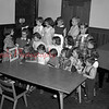 (05.03.53) Children's house at St. John's Reformed Church is shown. Gretchen Baer, left, telling a story to, front row, Lynn Broscious, Lois Miller, Barbara Phillips, Judy Foieri, Cheryl McIntyre, Holly Wilson and Timmy Baer; second, Judy Twiggar, Linda Richards, Connie Welker, Nancy Ufberg, Jackie Wilson and Marilee Edmundsl third, Faye Wetzel, Bonnie Johnson, Jeanette Lark, Glenn Faust and Dorothy Faust.