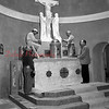 (02.02.56) Installation of a marble altar by Msgr. Thomas Bartol, extreme left, and the employees of the Guiseppi Tommasi Studio, New York.