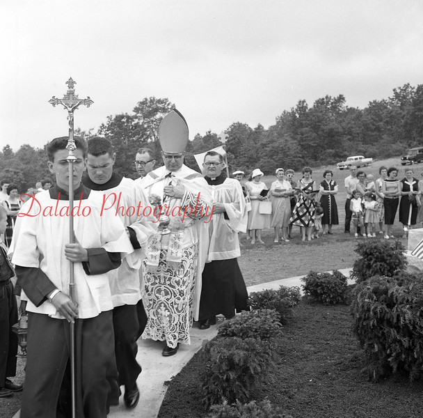 (June 1959) Dedicated to Rev. Vincent Wojno, former pastor at St. Casimer's Church, Kulpmont, Most Rev. Lawrence Schott, Mount Carmel, auxiliary bishop of the Harrisburg Diocese, blesses a crucifix at St. Casimir's Cemetery.