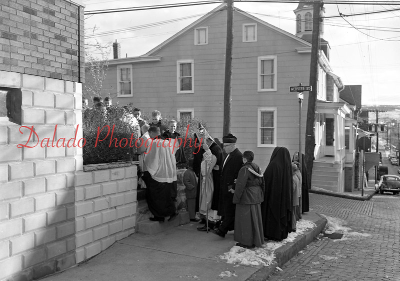 (12.04.58) Procession leaves new convent building, Webster and Vine streets, after blessing by the Rev. Lawrence Schott, aux. Bishop of Harrisburg. Recently remodeled structure was purchased by the parish in Sept. 1957 and the Sisters of St. Cyril and Methodius moved in the building in Feb. Delivering the sermon was Father Thomas Leitch, principal of the Central Catholic High School.