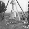 (May 1956) A white granite crucifix, 13 feet high, is erected at the St. Michael's Church Cemetery by workmen. Rev. John Klimas, pastor, said the monument will be dedicated on Memorial Day.