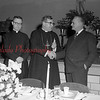 (11.24.1955) Attorney John Pipa Jr., right, congratulates the speaker, retired Rev. Theodore Kojis, O.S.B. Abbot of St. Andrews Abbey, Cleveland, at the 50th anniversary banquet at St. Mary's Church on Nov. 24, 1955. Rev. Charles Petrasek looks on.
