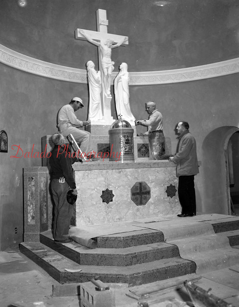 (02.02.56) Installation of a marble altar at St. Anthony's by Msgr. Thomas Bartol, extreme left, and the employees of the Guiseppi Tommasi Studio, New York.