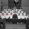 (1962) In this picture is Fr. Daniel J. Mahoney and a class of alter boys from St. Joseph's Church.  The church was the old St. Joseph's Church when it was above the school where the gym is now.  After the new church was built it was converted to a gym and for a long time they had mass in the cafeteria on the half hour.