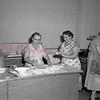 (02.16.56) Doughnut Day at St. Stephens Church. Adding sugar to the finished product are Sophia Firek, left, and Kathy Wesloskie.