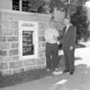 (09.27.56) New cornerstone roster in front of St. Paul's Reformed Church in Gowen City. Russell Frederick, 336 S. Coal St., Shamokin, built the roster in the while the bulletin board is mounted. He is joined by Rev. Thomas Rissinger, pastor.