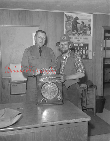 (1964) Centennial, Mr. Dowskus and an unknown man with a slot machine.