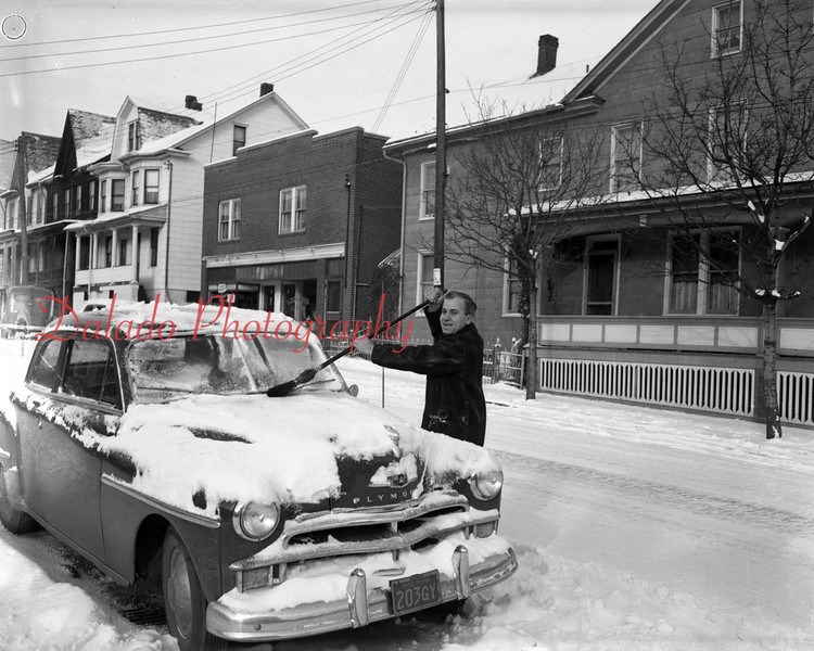 (Jan. 1951) Car in the snow.