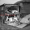 (08.05.1952) This is the home of Margaret Cowley, Craigs Patch, which is almost demolished following an explosion of a truck that caught fire on Route 44 between Mahanoy City and Brandonville on Aug. 5, 1952. This house is located about 100 yards from the roadway when the truck, reportedly owned by the Independent Explosives Co.  The truck was blown to bits. Pieces of the vehicle were found 50 feet from the crater, that was 30-by-15 feet. Trees 100 yards from the roadway were burned.