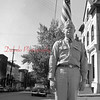 (1956, April through July) Veteran posing for a photo in front of the Shamokin Citizen.