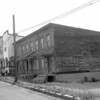 (1961) Dilapidated buildings, unknown location.