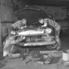 (1961) Teens fixing a car.