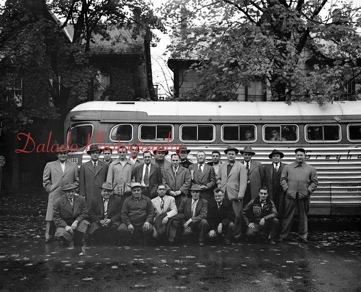 (11.01.1951) Group with a bus.