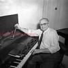 (Jan. 1951) Piano tuner.
