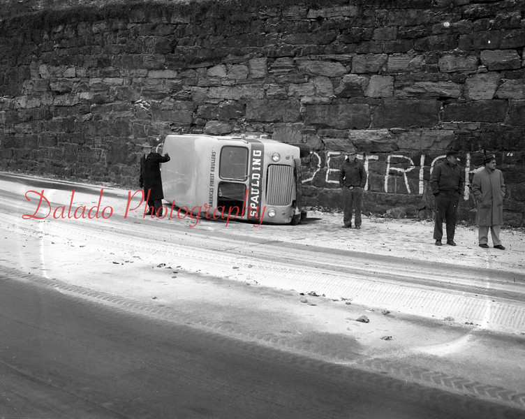 (12.18.1952) A slippery highway caused this crash about 1/2 mile south of Paxinos when a bakery truck driven by Douglas Snyder skidded on the highway.