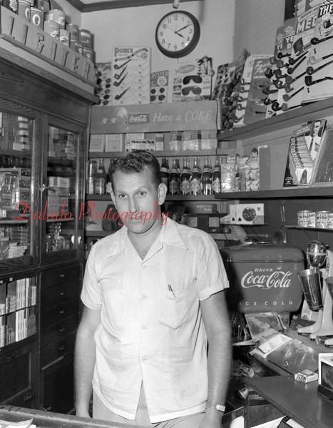 (08.21.1952) Guy in a store.