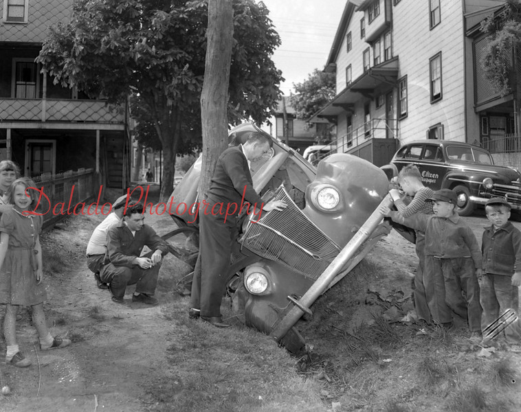 (05.14.1952) Boys helping at the scene of a crash.