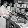 (10.15.53) Packing lunches for wards of the Odd Fello vs Orphanage, Snydertown, are Harold Herb and Ralph Rosini, of Rosini's Restaurant. The 50 orphanage wards were guests of Shamokin firms at the Pa. State Police Rodeo staged at Hazletown.