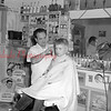 (April 1953) Johnny Concellos Barber Shop. (Unknown location)