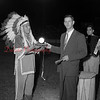 (9.15.53) Chief Halftown, who appeared at the Munsee Indian Dance Show, is presented with a gift from Albert Steibing, secretery of the Shamokin Optimist Club. Chief Haltown, a full-blooded Seneca Indian, was presented with a electric clock, the case of which was made from anthracite coal. More than 3,000 people saw the Munsee Indian Dancers, a group of Explorer Scouts from Allentown, who presented a program at the Coal Township High School Stadium under sponsorship of the Shamokin Optimist Club.