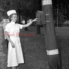 (10.15.53) Shamokin State Hospital nurse Joan Dennery testing a fire box.