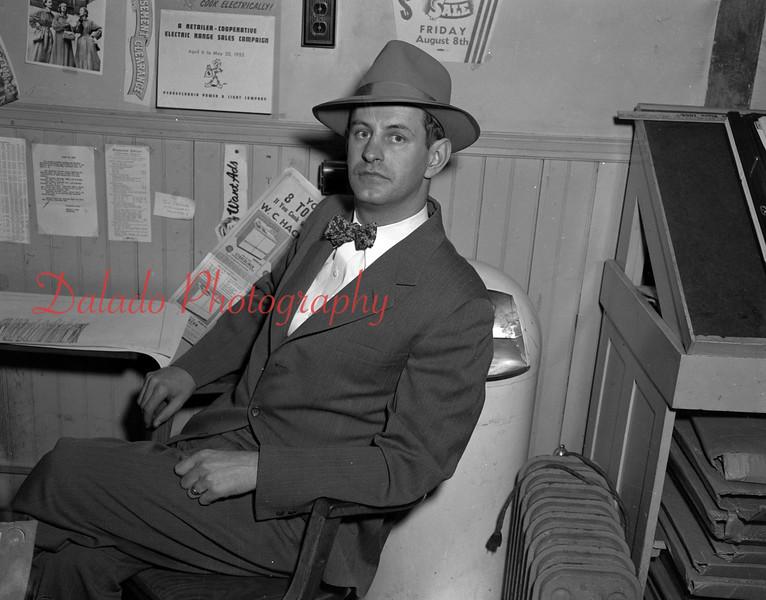(1953) Newspaper guy.