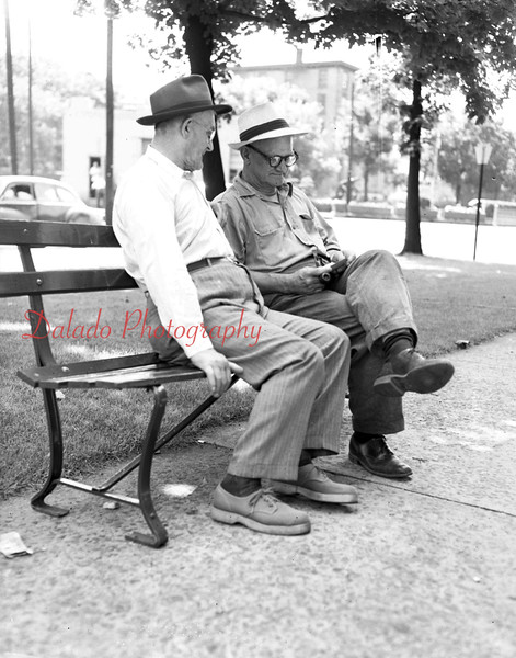 (06.24.54) Walter Landace, left, of 212 Spruce St., and Walter Zaleski, Weigh Scales, relaxin on new park benches at Market and Indepedence streets.