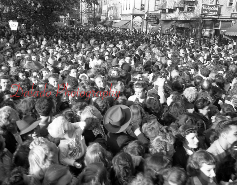 (1954) A lot of people here. Unknown.