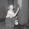 (06.24.54) Clarence Shively painting at SHS.