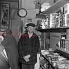 (March 1954) Grocery store man.