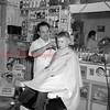 (April 1955) Unknown barber.