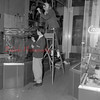 (Oct. 1955) Decorating a window in the business section of Mount Carmel are Danny Ciocco, 25 N. Tenth St., Kulpmont, and Angela Fincato, 222 W. Second St., Mount Carmel.